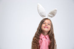 Portrait of a happy little girl with bunny ears Royalty Free Stock Image
