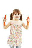 Portrait of happy little girl with carrots Stock Images