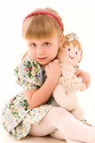 Portrait of happy little girl with a doll Royalty Free Stock Photography