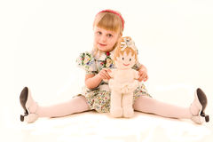 Portrait of happy little girl with a doll Stock Photo