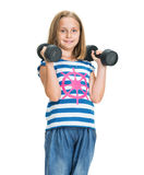 Portrait of happy little girl with dumbbells Royalty Free Stock Image