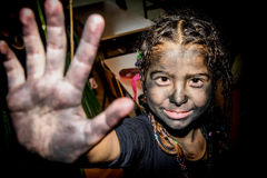 Portrait of a happy little girl with face painted with charcoal Royalty Free Stock Images