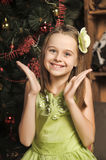 Portrait of a happy little girl in a green dress Royalty Free Stock Images
