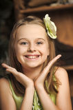 Portrait of a happy little girl in a green dress stock image