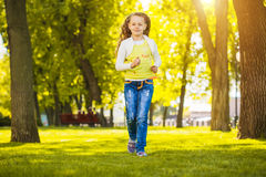 Portrait of a happy little girl in the green park Stock Photo