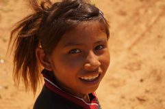 Portrait of a happy little girl guarani. Portrait of an amused and indigenous little girl guarani in Paraguay Stock Image