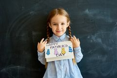 Cute Little Girl Holding Greeting Card for Fathers Day Royalty Free Stock Images