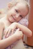 Portrait of happy little girl holding toy Royalty Free Stock Photos