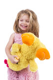 Portrait of a happy little girl holding a yellow plush toy Stock Image