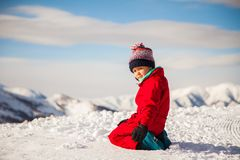 Portrait of happy little girl playing on the top of mount with ice and snow royalty free stock image