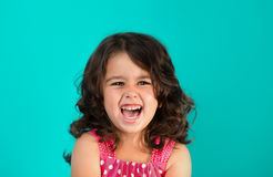 Portrait of a happy, little girl. Portrait of a happy, positive, smiling, little girl, cyan background Stock Photography
