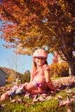 Portrait of happy little girl in roller skates stock image