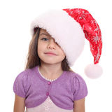 Portrait of happy little girl in Santa hat Stock Images