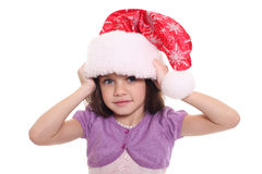 Portrait of happy little girl in Santa hat Royalty Free Stock Photography