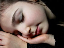 Son. Portrait of happy little girl sleeping in her bed royalty free stock photos