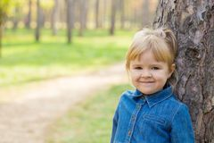 Portrait of happy little girl with smile on face on sunny day stock photography