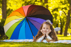Portrait of a happy little girl with umbrella Royalty Free Stock Photography