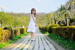 Portrait of happy little girl whith cherry tree flowers Stock Images