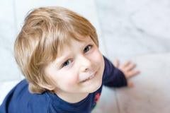 Portrait of happy little kid boy in indoors Stock Image