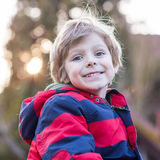 Portrait of happy little kid boy in red jacket, outdoors Stock Photography