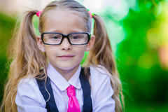 Portrait of happy little school girl in glasses Royalty Free Stock Image