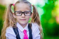 Portrait of happy little school girl in glasses Royalty Free Stock Image