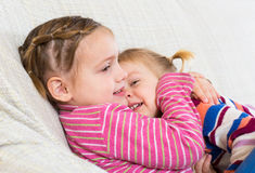 Portrait of happy little sisters Royalty Free Stock Photos