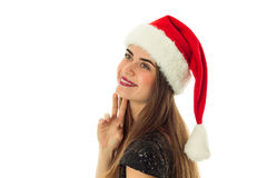Portrait of happy lovely woman in santa hat. Looking and smiling on camera in studio isolated on white Royalty Free Stock Images