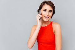 Portrait of a happy lovely woman talking on the phone Royalty Free Stock Images