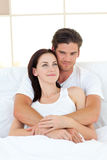 Portrait of happy lovers hugging in their bed Royalty Free Stock Photography