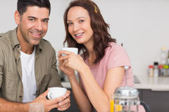 Portrait of a happy loving couple with coffee cup Stock Photography