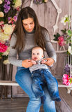 Portrait of happy loving mother and her baby boy indoors Royalty Free Stock Photo