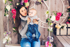 Portrait of happy loving mother and her baby boy indoors Royalty Free Stock Photography