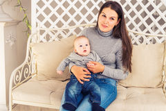 Portrait of happy loving mother and her baby boy indoors Stock Images