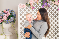 Portrait of happy loving mother and her baby boy indoors Stock Photos