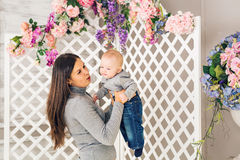 Portrait of happy loving mother and her baby boy indoors Stock Photography