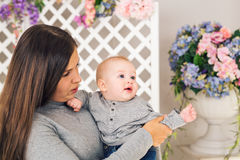 Portrait of happy loving mother and her baby boy indoors Royalty Free Stock Photos