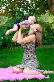 Portrait of happy loving mother and her baby outdoors Stock Photos