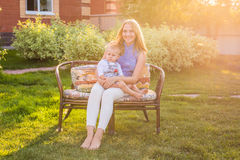 Portrait of happy loving mother and her baby outdoors. Stock Image