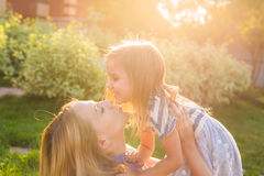 Portrait of happy loving mother and her baby outdoors. Royalty Free Stock Image