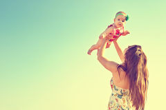 Portrait of happy loving mother and her baby outdoors. Mother and child in summer Stock Photo