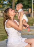 Portrait of happy loving mother and her baby Royalty Free Stock Photo