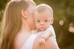 Portrait of happy loving mother and her baby Stock Images