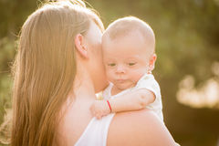 Portrait of happy loving mother and her baby Stock Image