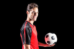 Portrait of happy male athlete holding football Royalty Free Stock Image