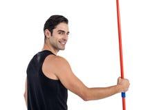 Portrait of happy male athlete holding javelin Stock Image