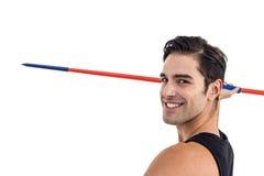 Portrait of happy male athlete holding javelin Stock Photos