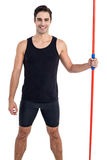 Portrait of happy male athlete holding javelin Royalty Free Stock Photo