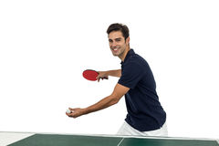 Portrait of happy male athlete playing table tennis Stock Photo