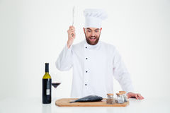 Portrait of a happy male chef cook cutting fish Royalty Free Stock Photo